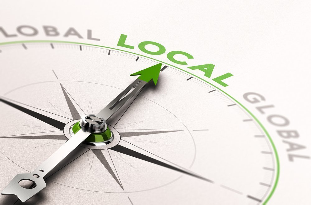 Compass that points towards the word Local
